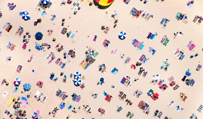 Image of people laying out on the beach