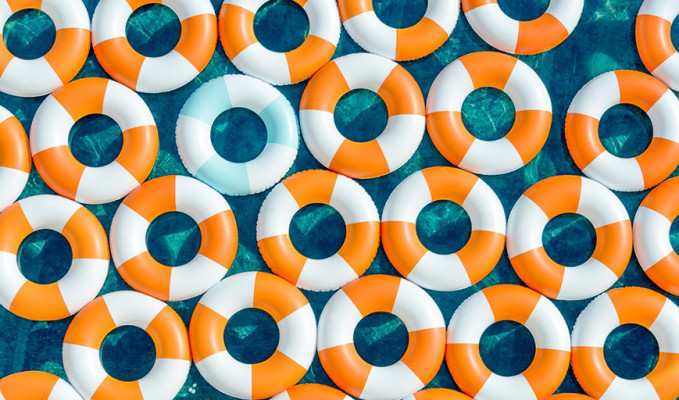 Photograph of orange and blue innertubes in a pool.