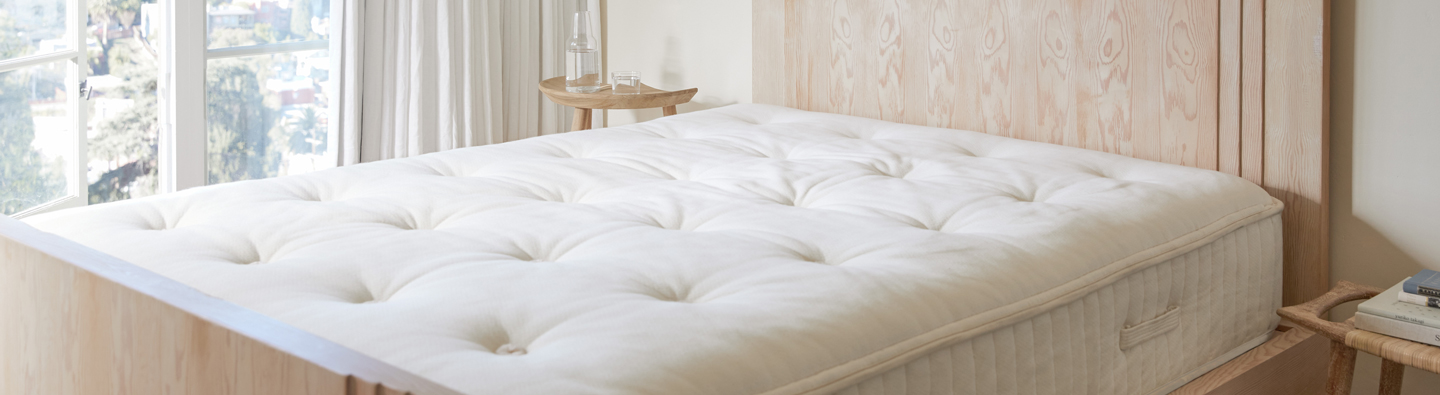 Close up of a bare mattress on a bed frame
