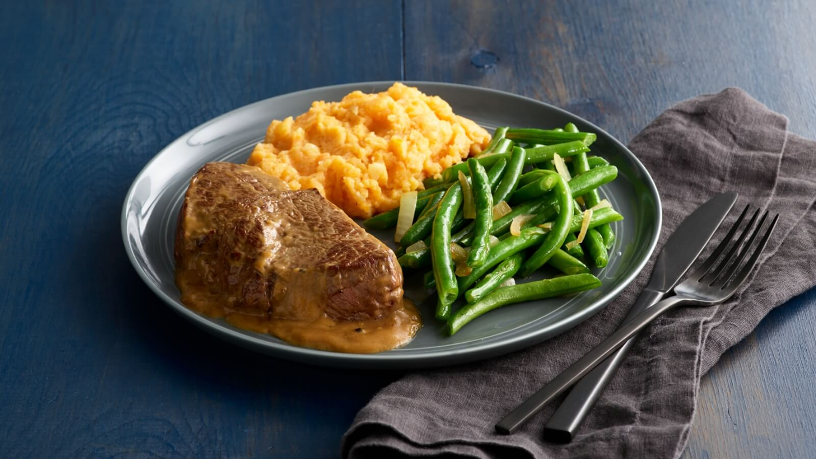 Bourbon Peppercorn Steak with Mashed Sweet Potatoes & Green Beans
