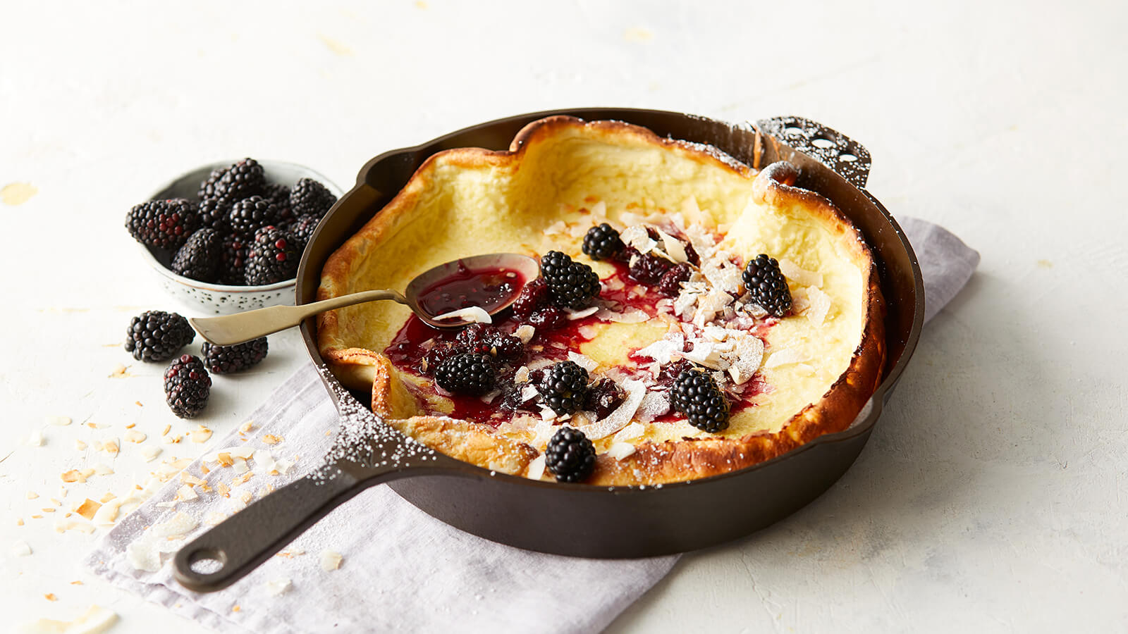 Dutch Baby Pancake with Blackberries and Toasted Coconut