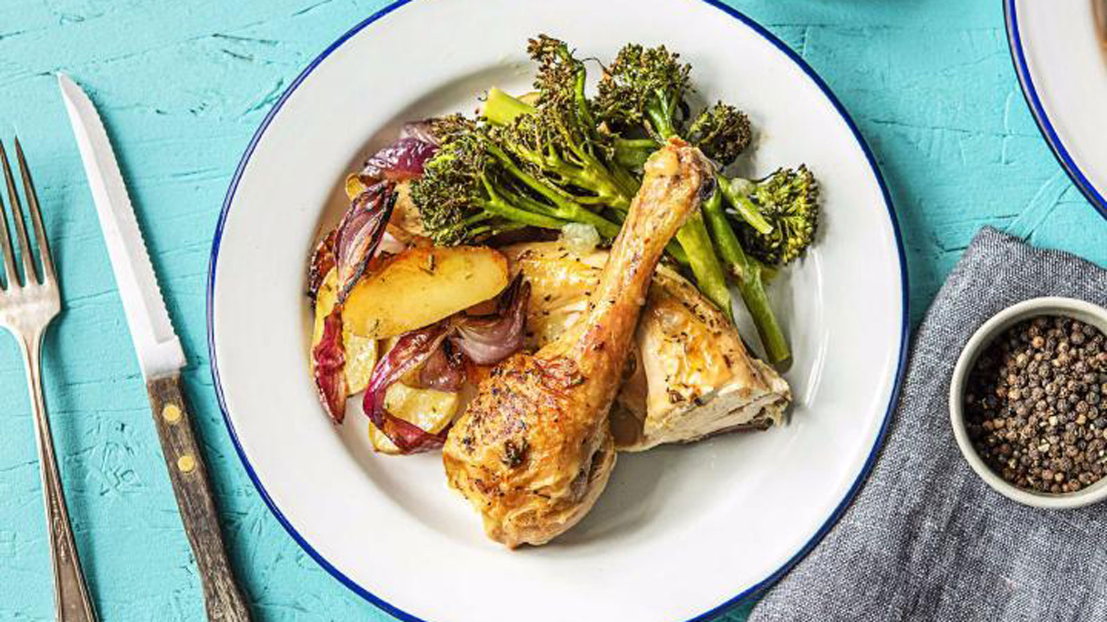 Chicken-Under-a-Brick-with-Baby-Broccoli,-Lemon,-and-Fingerling-Potatoes