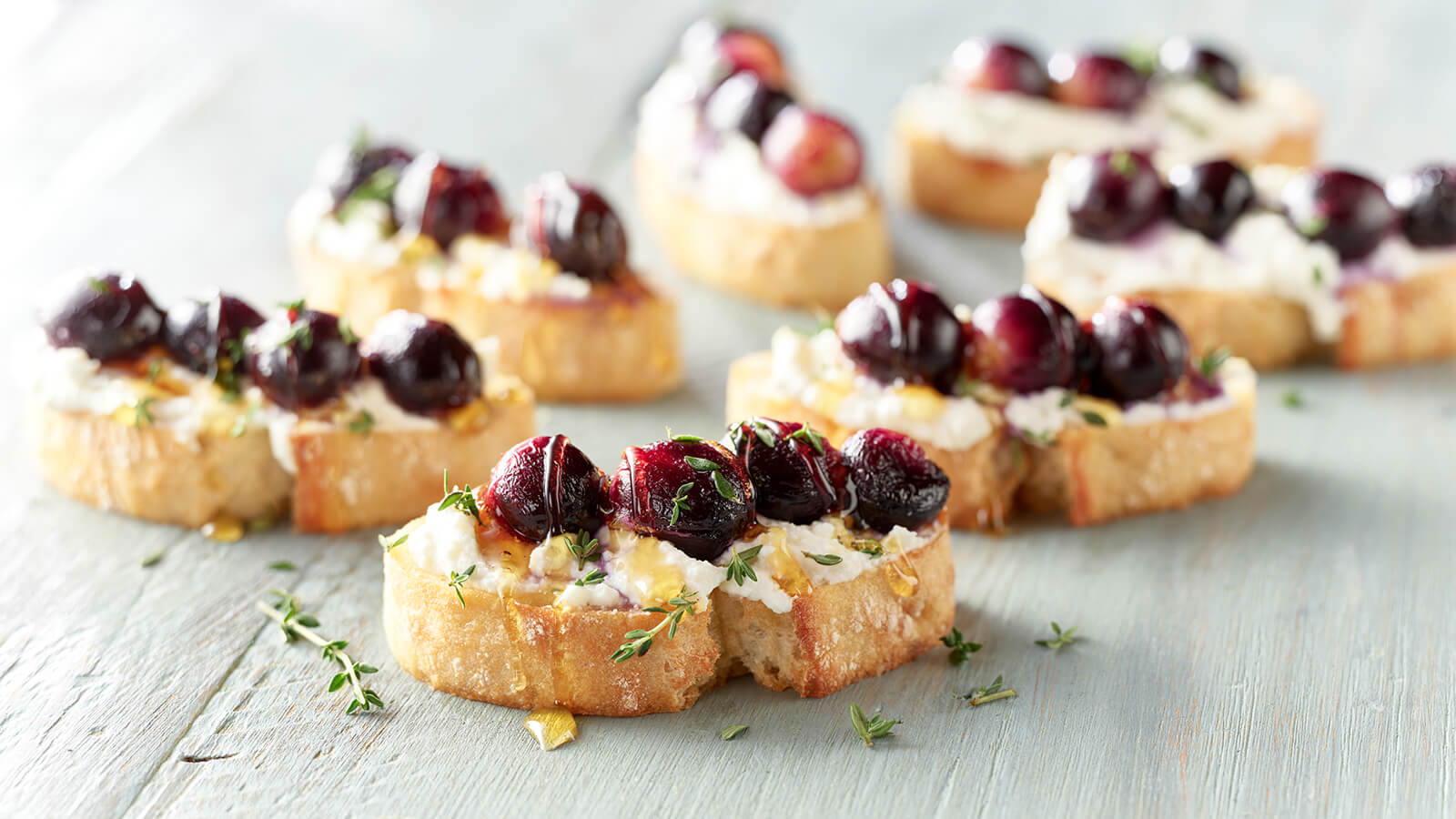 Roasted Grape Crostini with Lemon Ricotta and Thyme