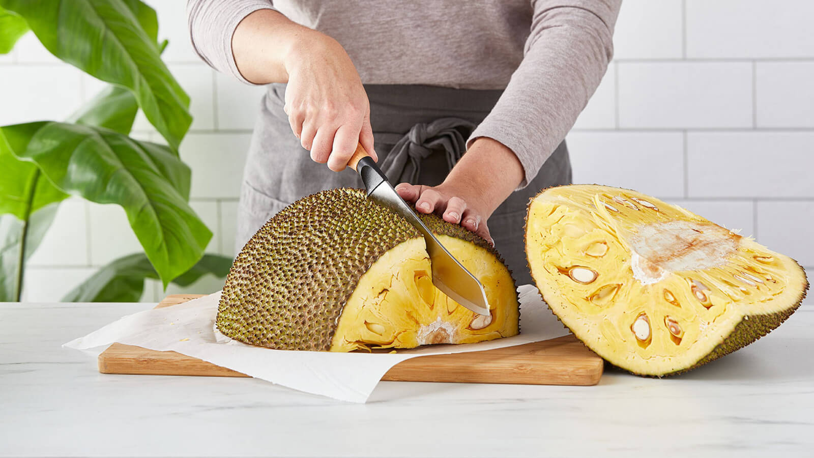 step 3 Slice jackfruit into quarters