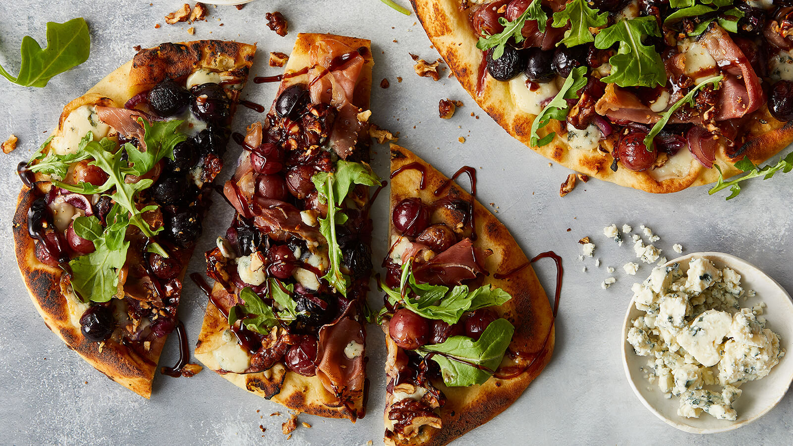 Roasted Grape Flatbread with Blue Cheese and Prosciutto