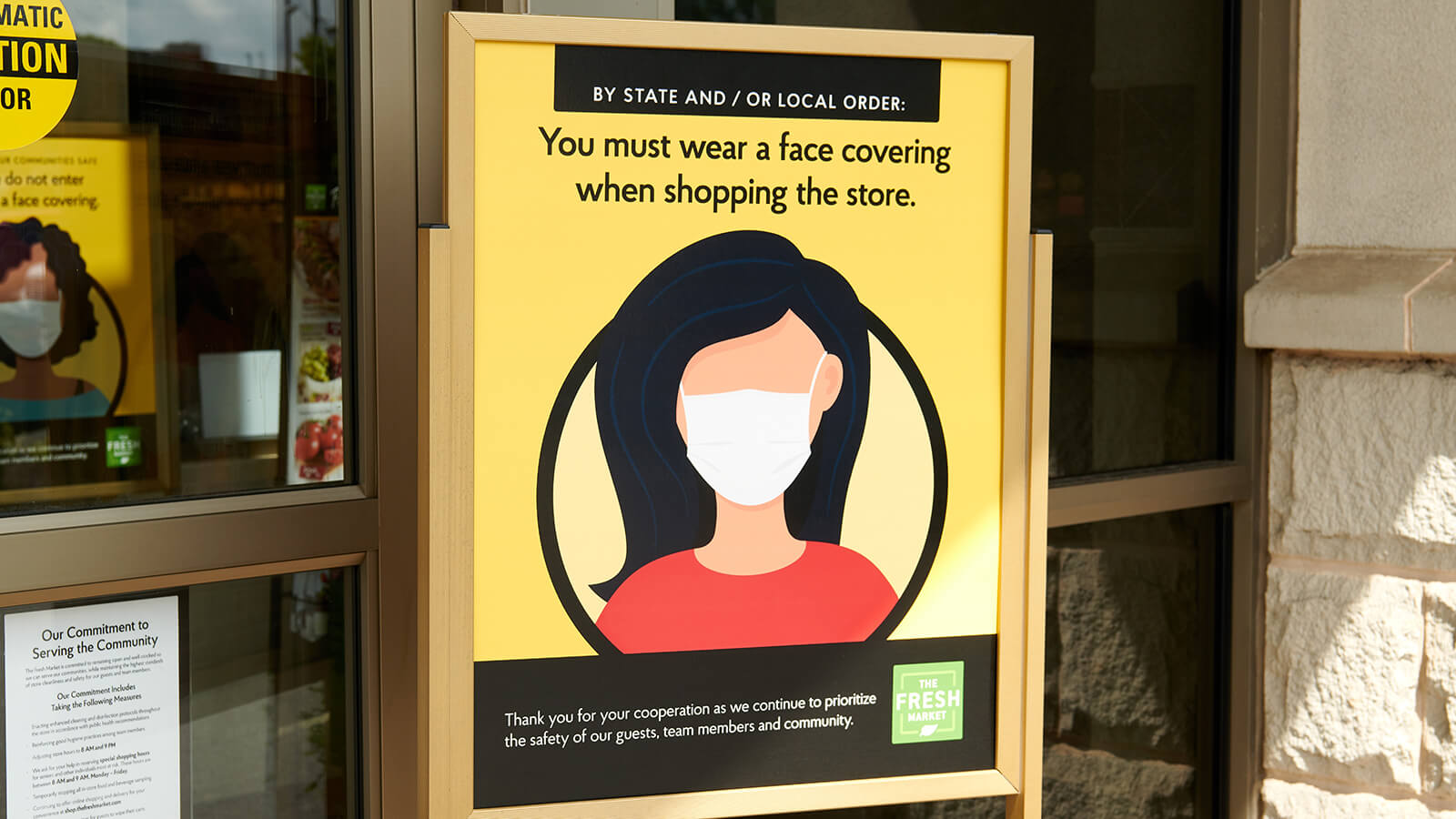 wear a face mask signage in store