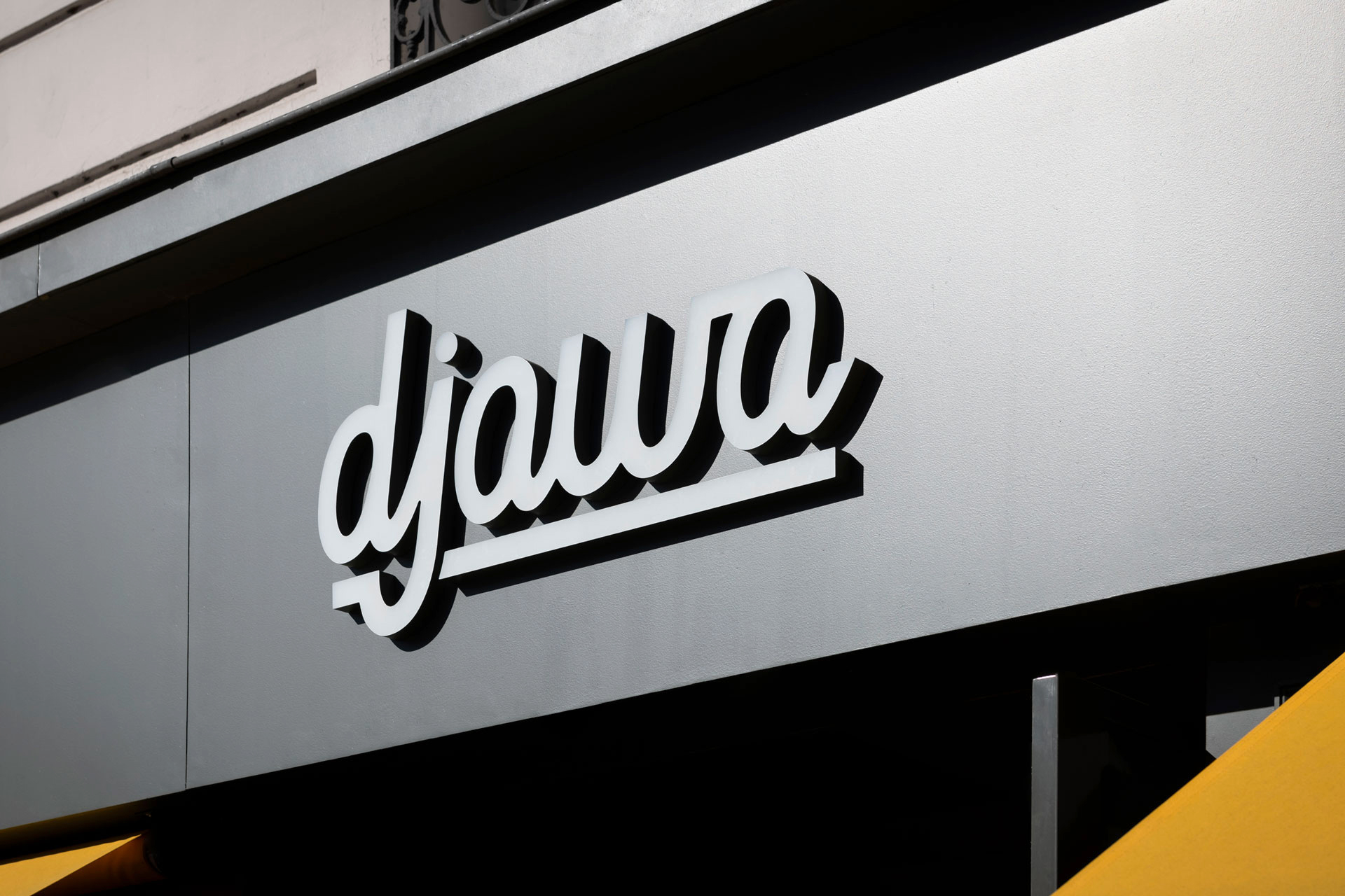 Djawa - restaurant - interior architecture - Paris - neon sign - facade