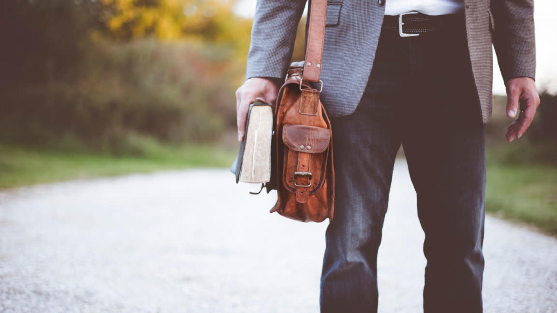 Man carrying Bible and satchel