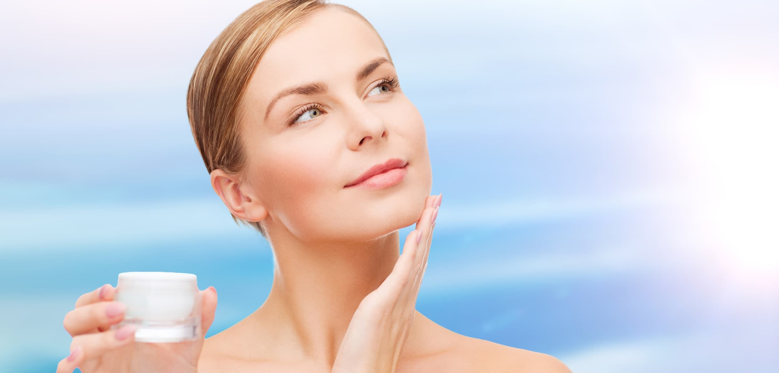 A woman gracefully touching her face - skincare routine with tretinoin