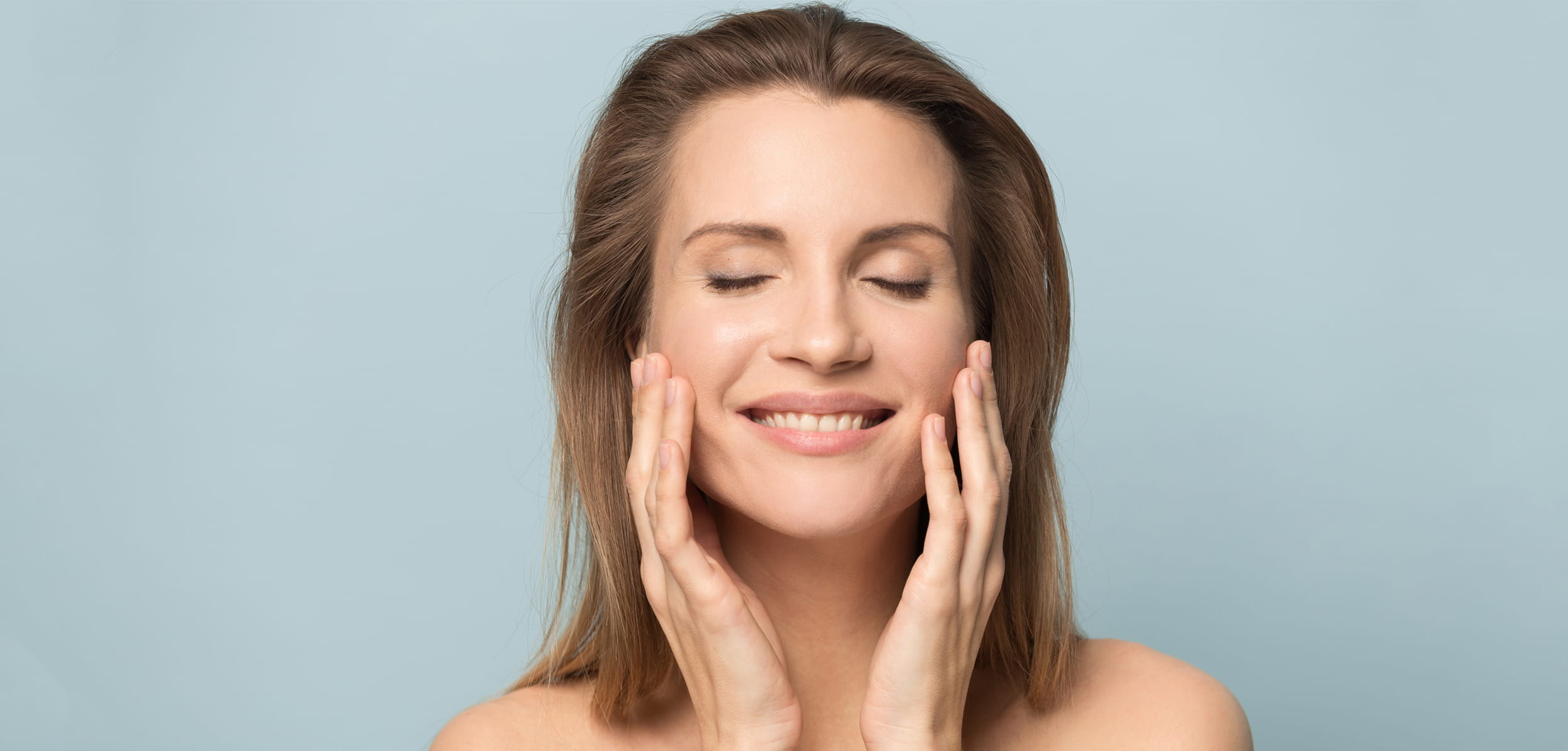 Women touching her face - Acne Treatments: 5 Adult Acne Prevention Techniques