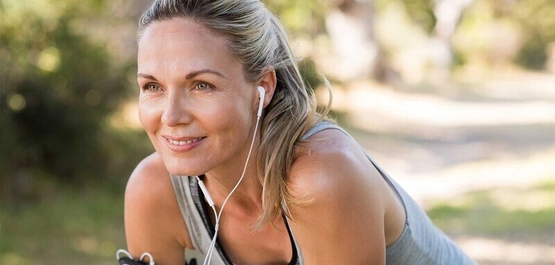 Happy woman listening to music - Cardiovascular Disease Prevention & HRT