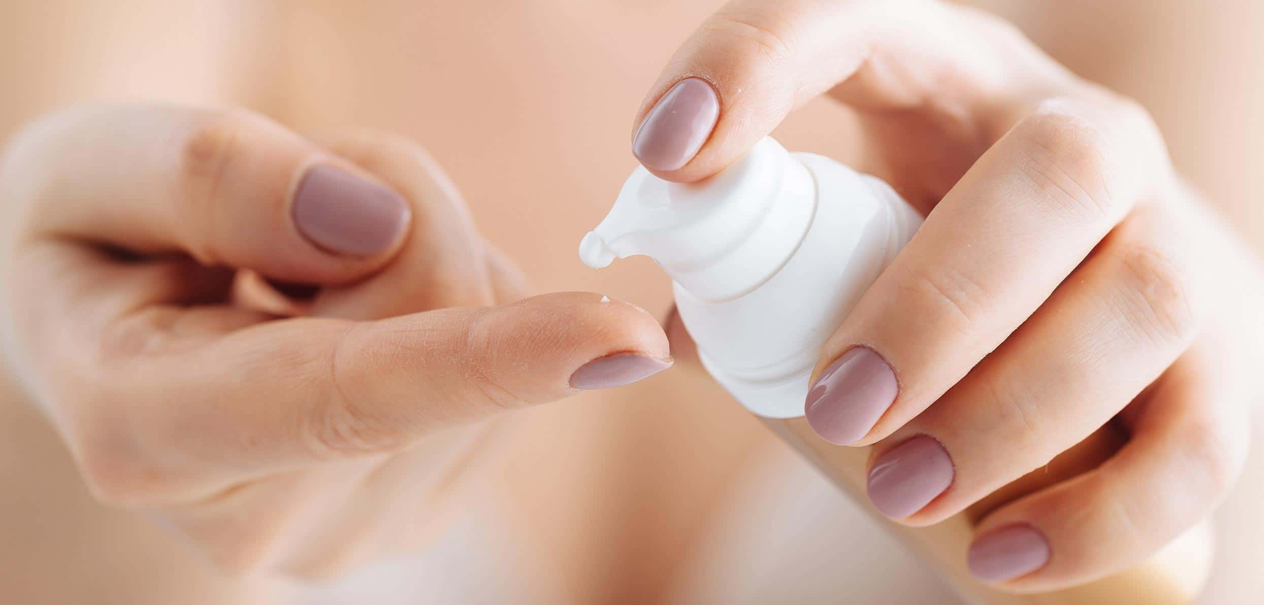 Woman's hand taking a drop of hand cream - bioidentical hormones
