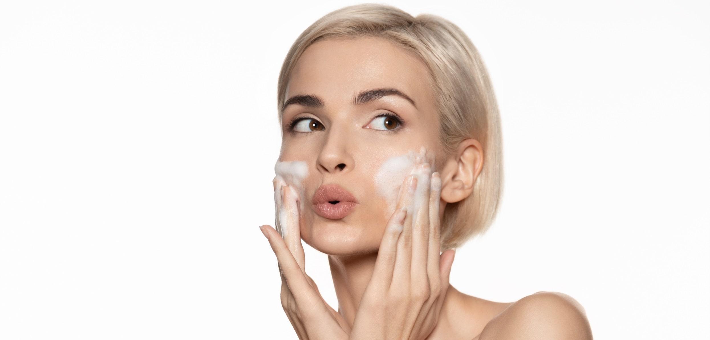 Woman washing her face - diy exfoliation