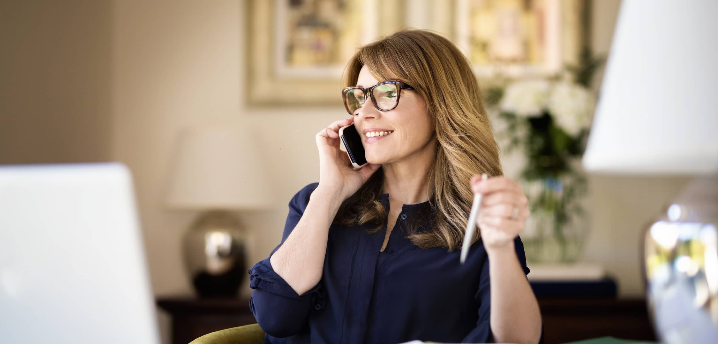 Woman taking a call in the office - menopause in the workplace