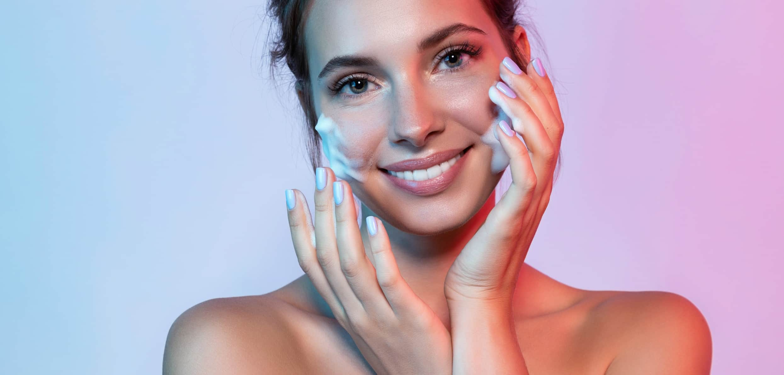 Smiling woman with soap bubbles in her face - diy skin care treatments