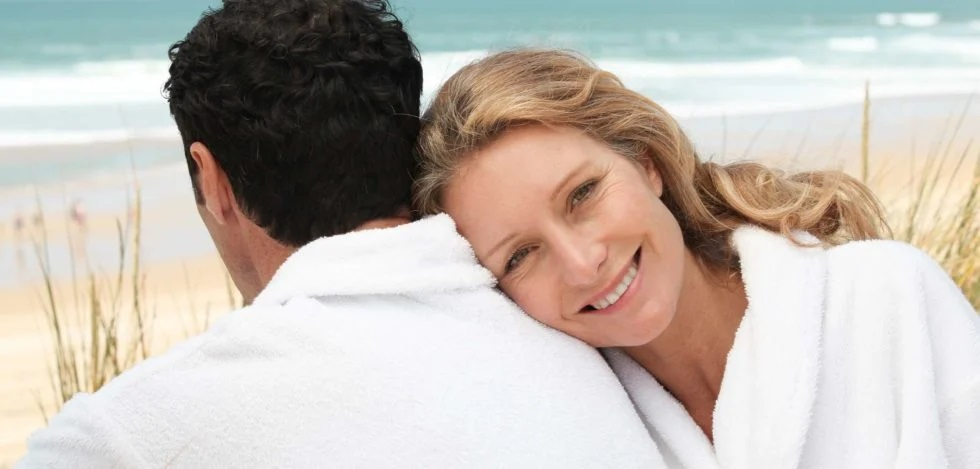 Happy woman leaning in the back of his man - normal testosterone levels in women