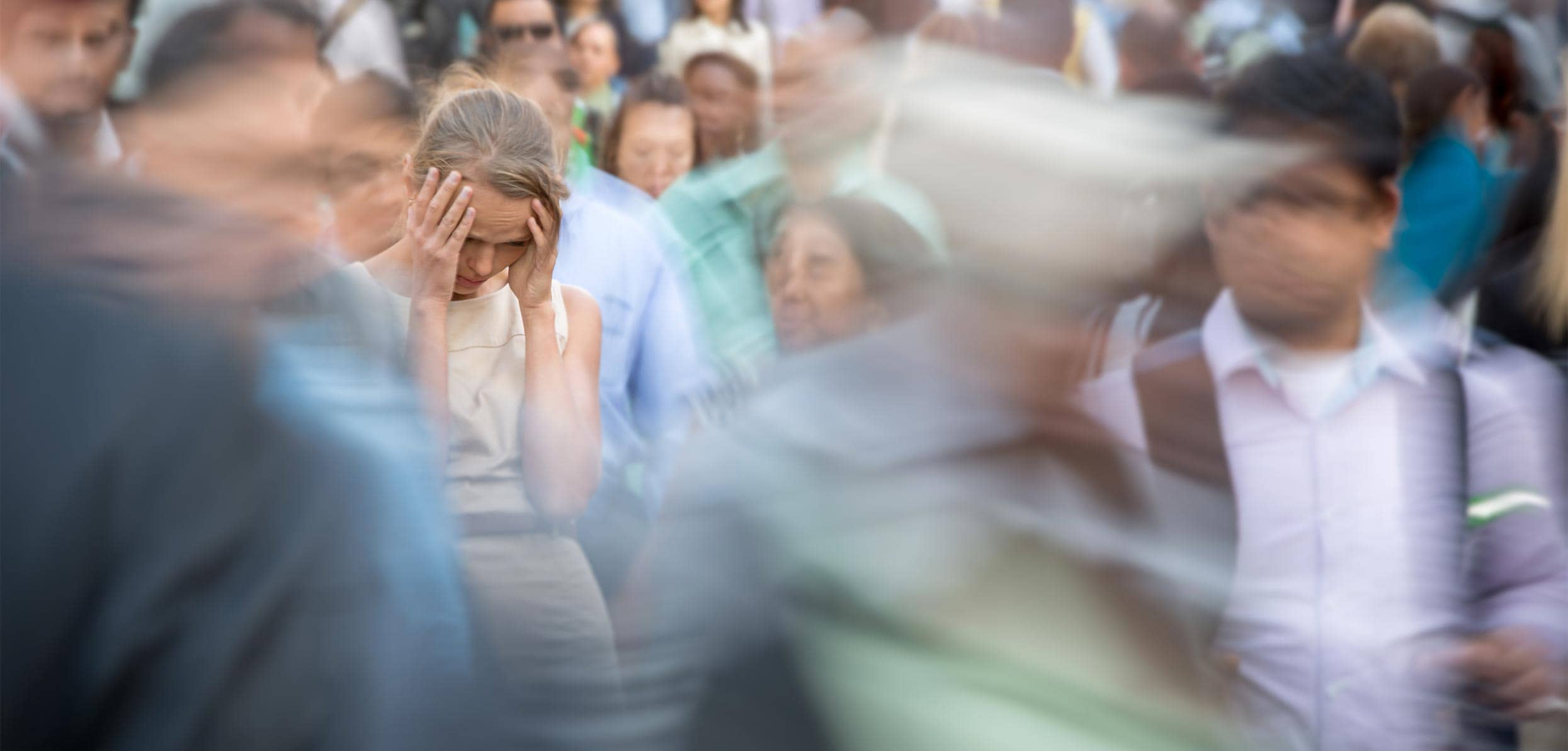 woman suffering from headache in a crowded place - hormonal fluctuations