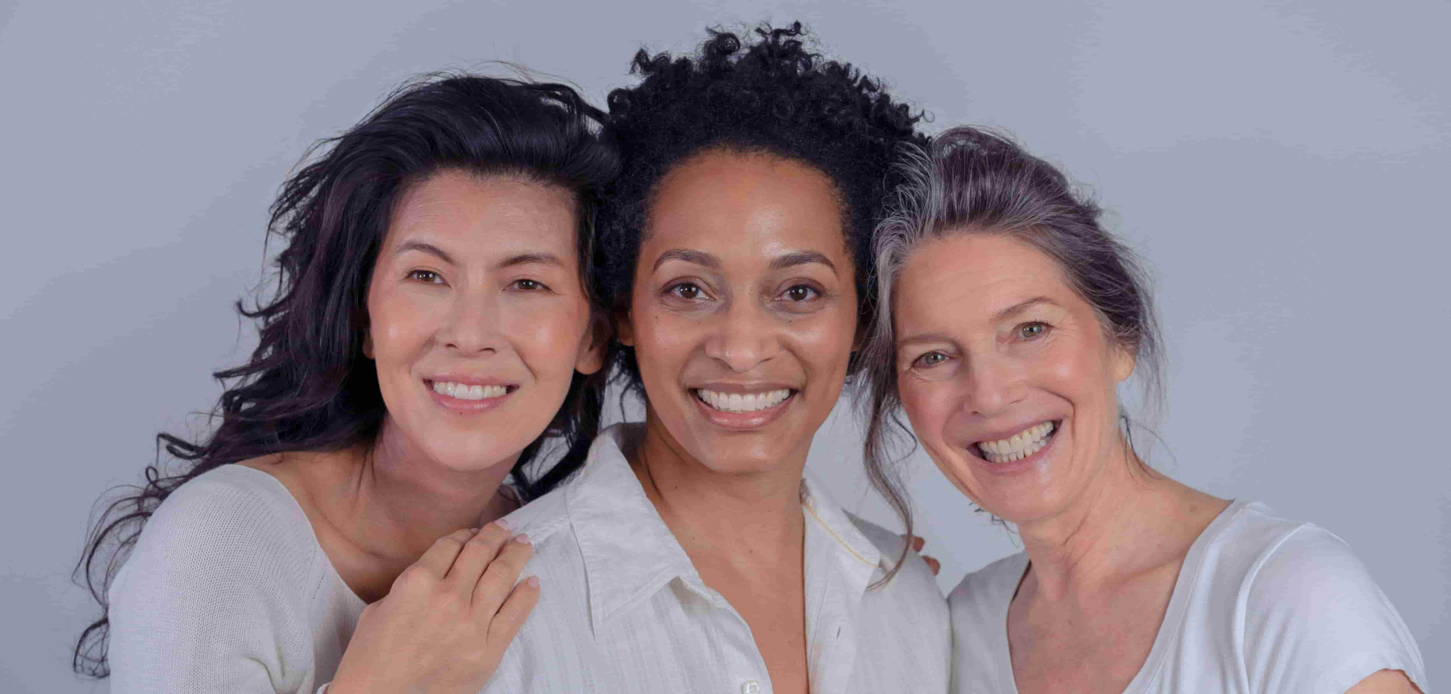 Three women smiling in front of the camera - womens health initiative study