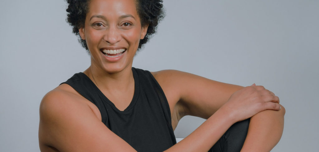 A woman smiling about the benefits of testosterone during menopause