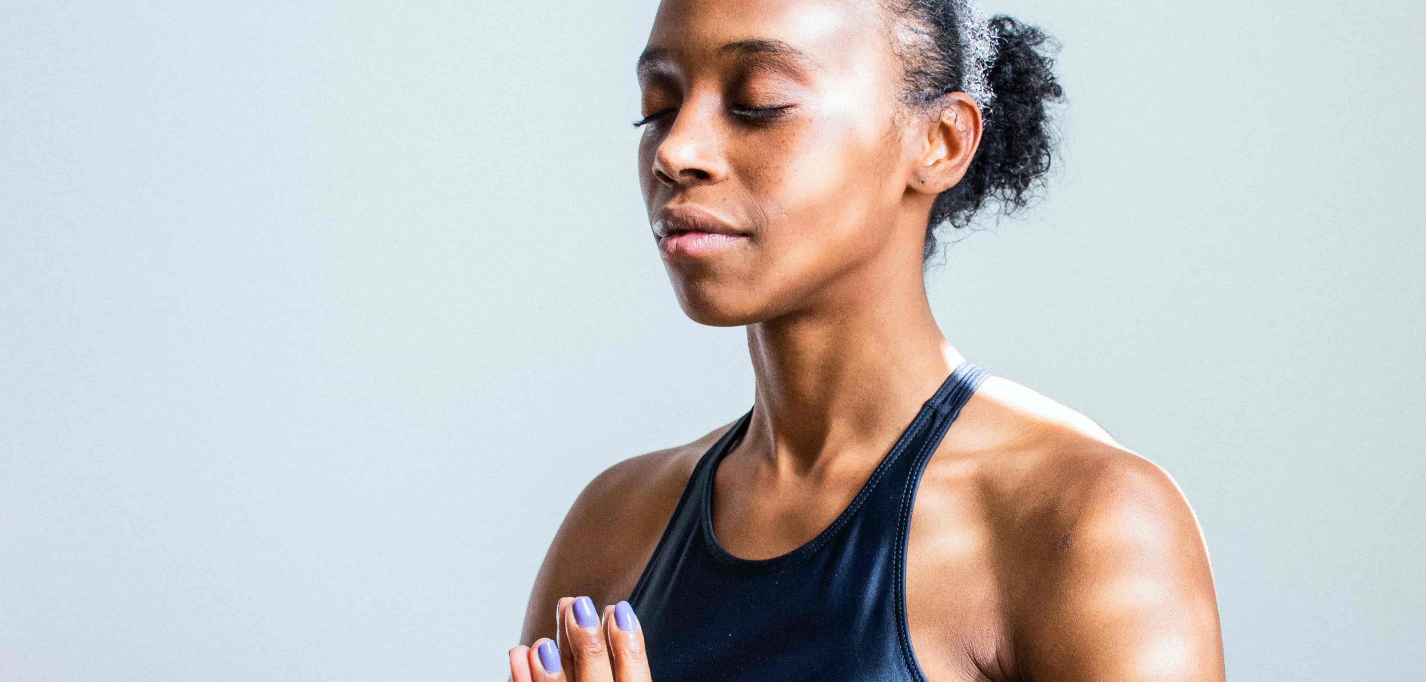 Meditating woman with a dark blue sleeveless shirt - antidepressants for menopause
