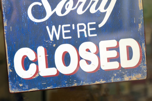 Sorry we're closed sign on shop window