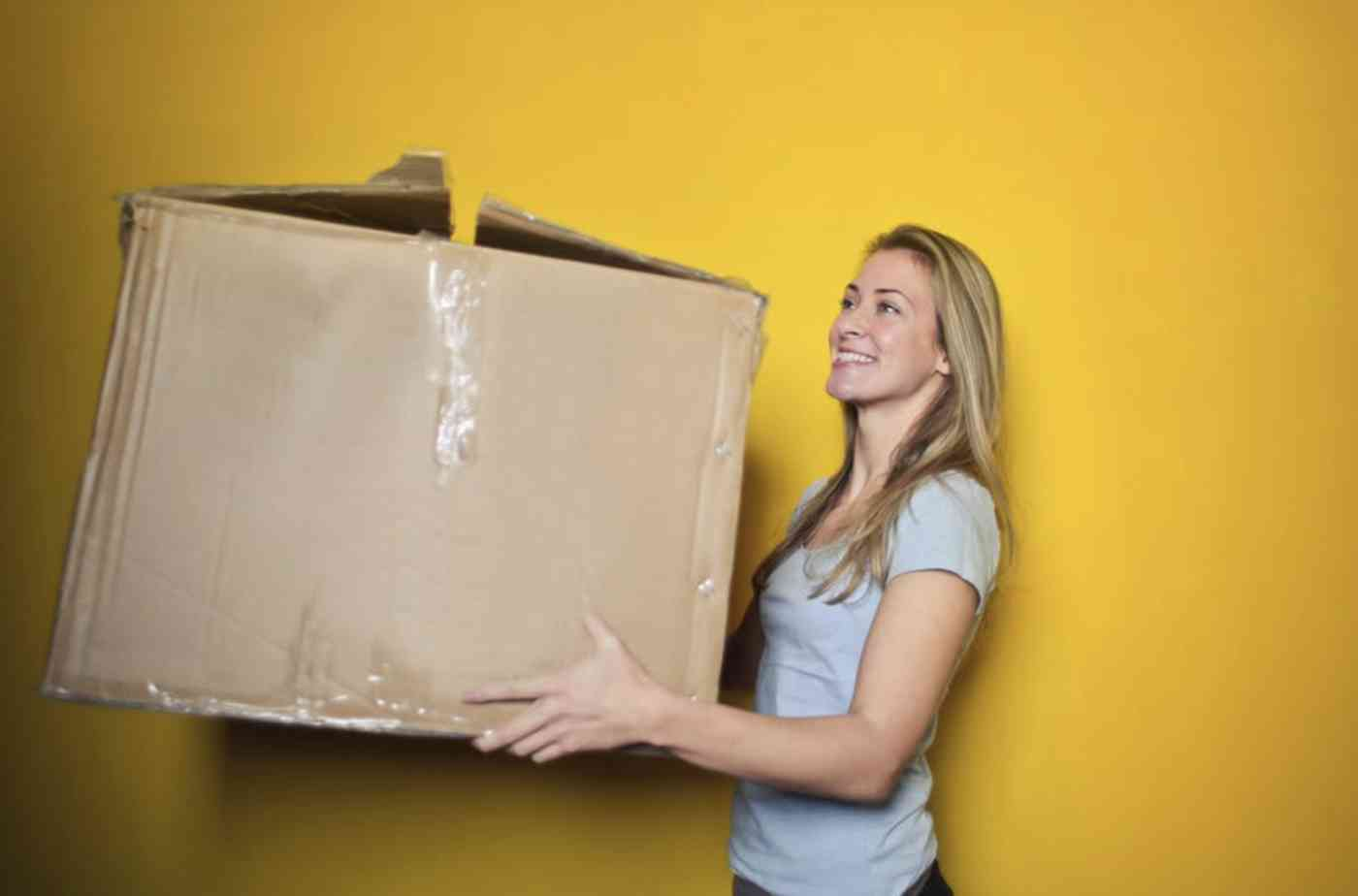 Woman holding a large box