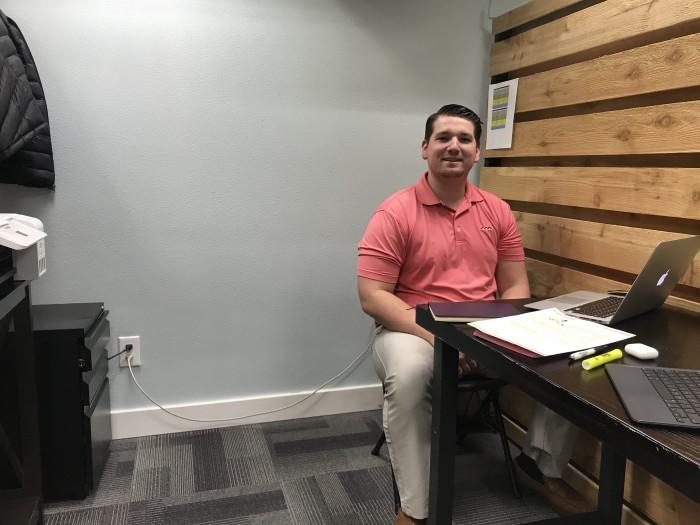 Jake at his desk