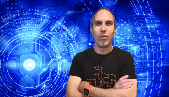 Ben in front of a circuit board background