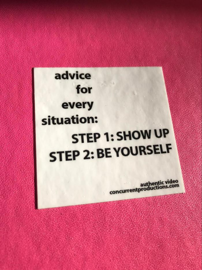 A motivational sticker that says Step 1: Show up Step 2: Be yourself