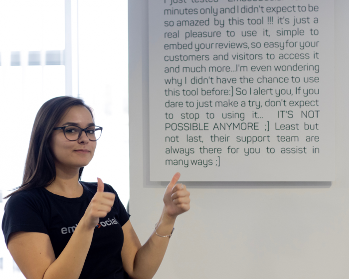 A poster of a testimonial in EmbedSocial's office