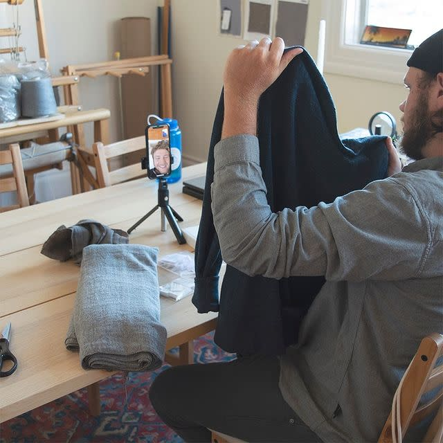 A photo of someone making a video about the sweater