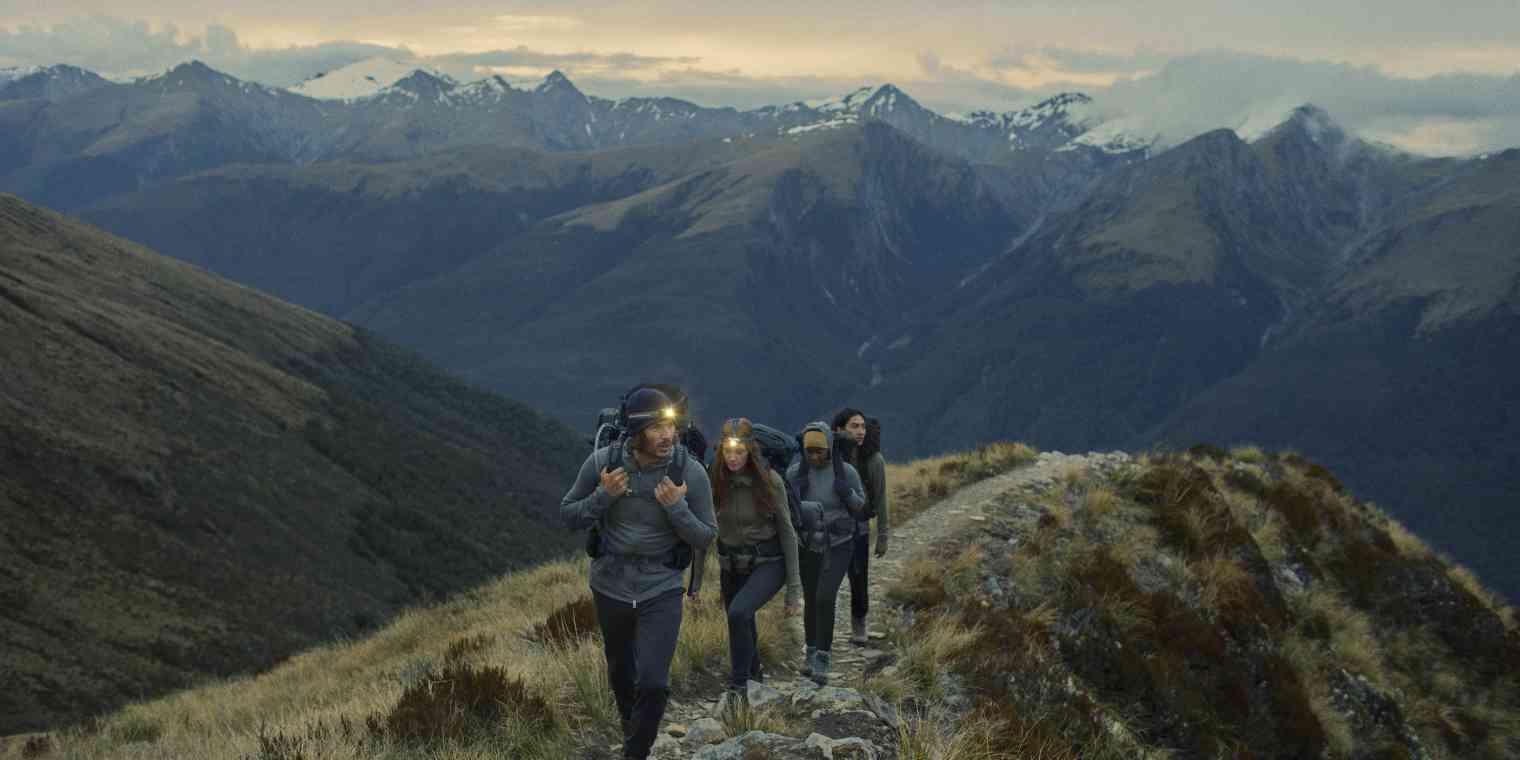 Icebreaker customers wearing outdoor gear on a mountain