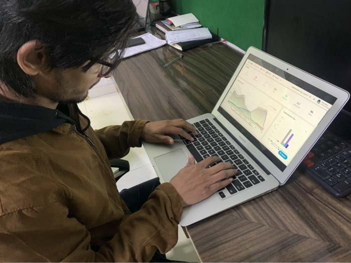 One of our team members analyzing bot's performance