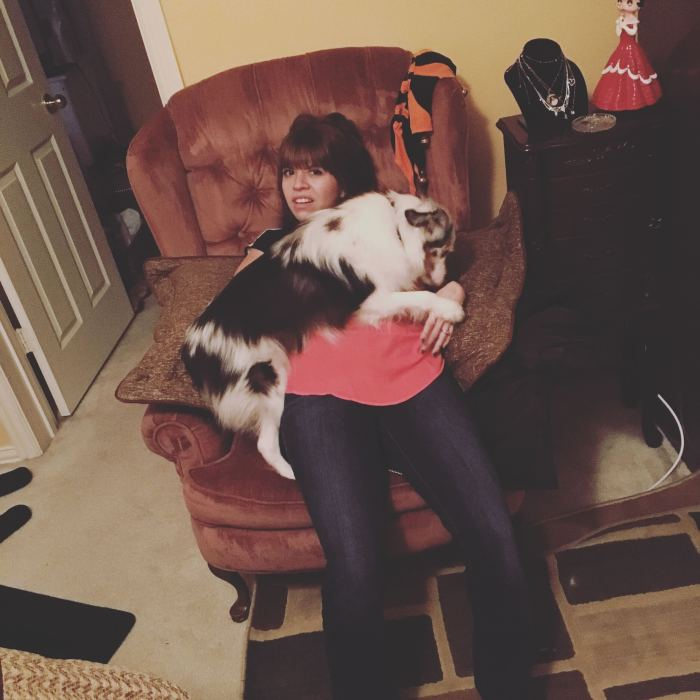 Krystina snuggling with a very beautiful dog