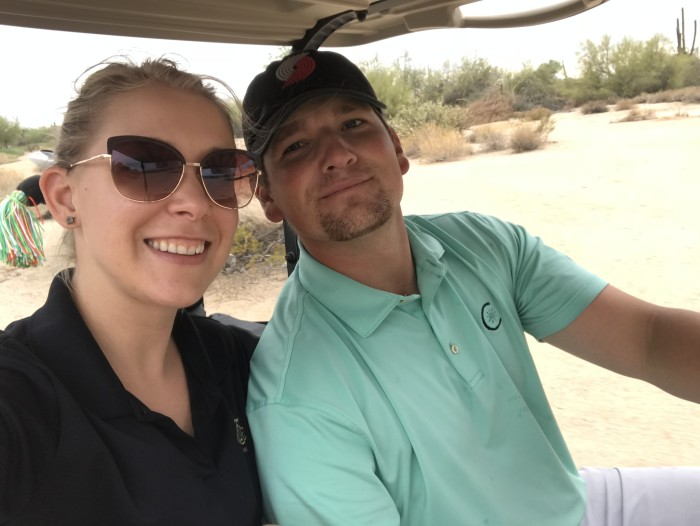 Jake and his wife in a golf cart