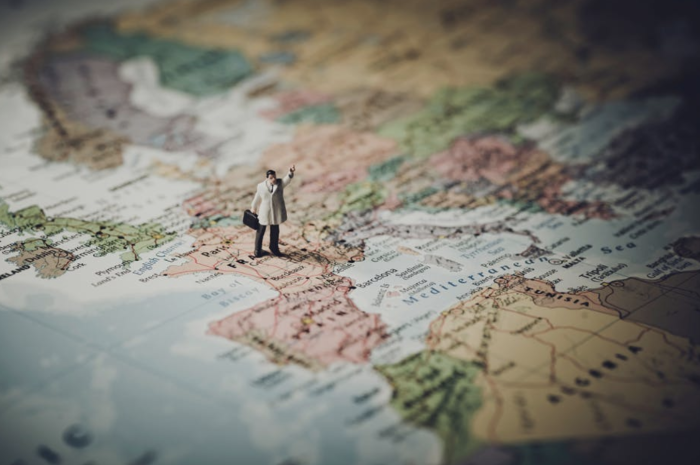 Figurine standing on a map