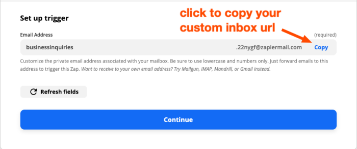 The trigger set-up step in the Zap editor. A red arrow highlights the action to copy the custom email address link.