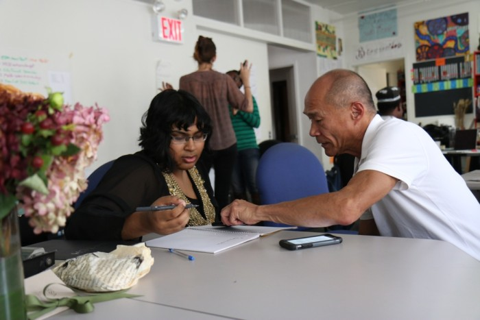 Two people at a table looking at a piece of paper