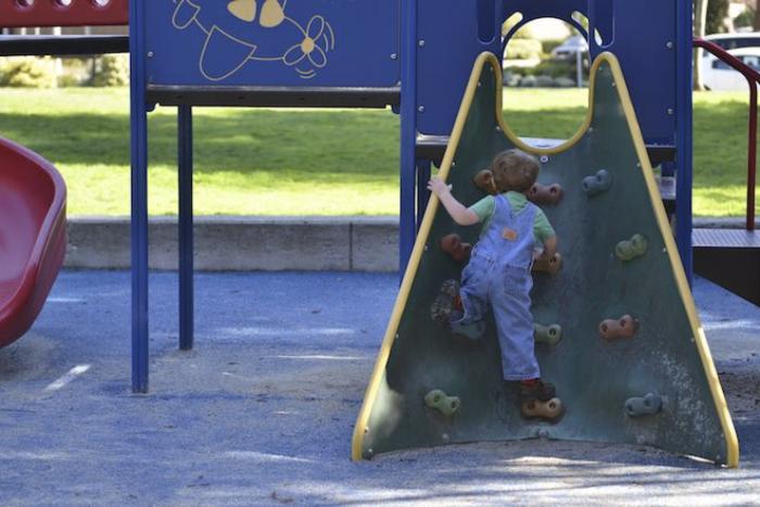 Kid climbing on a playground