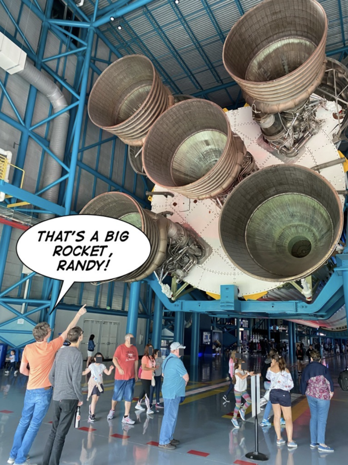 Bryan pointing at a rocket with a speech bubble that says That