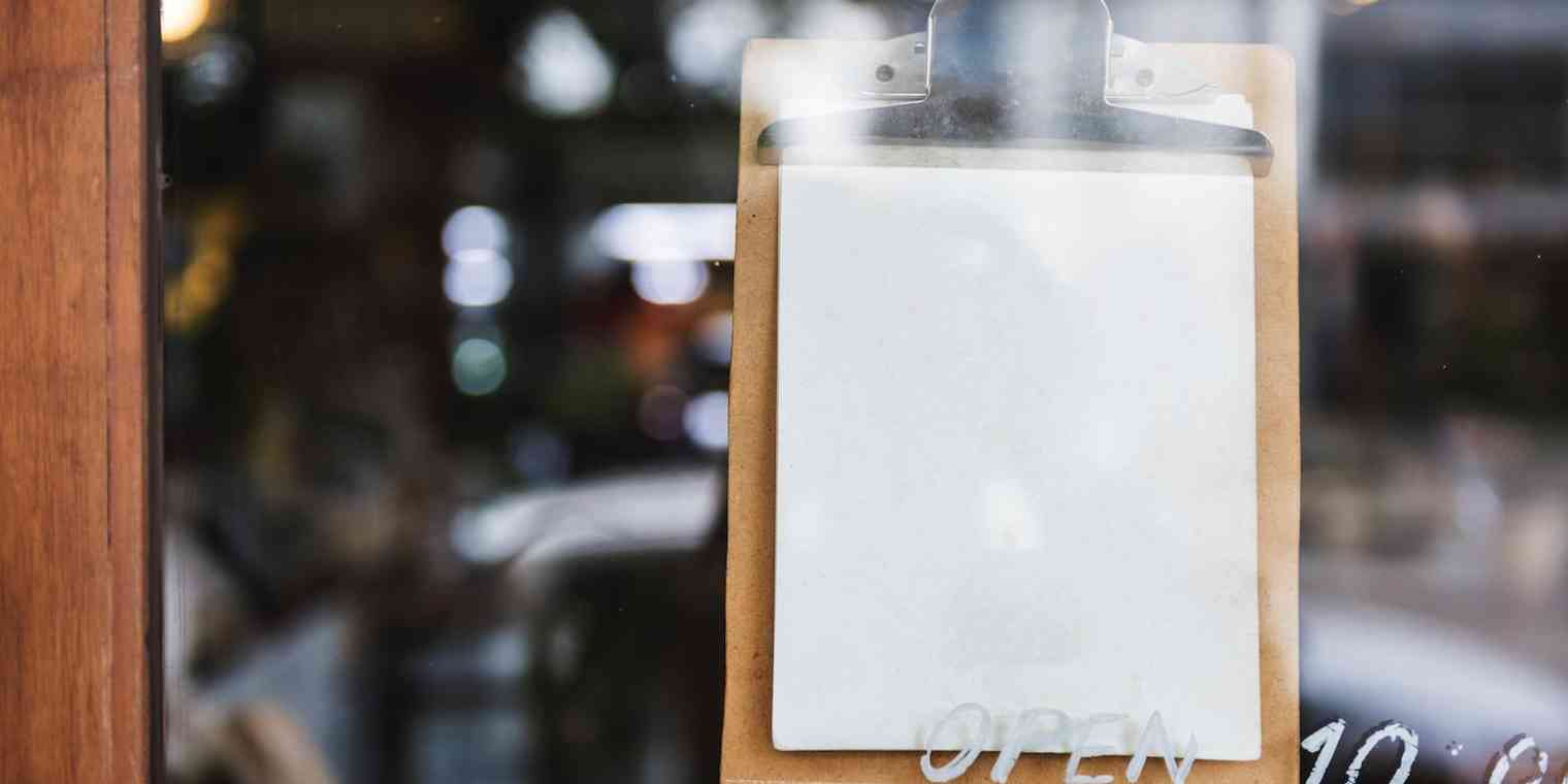 A clipboard hanging in a window.