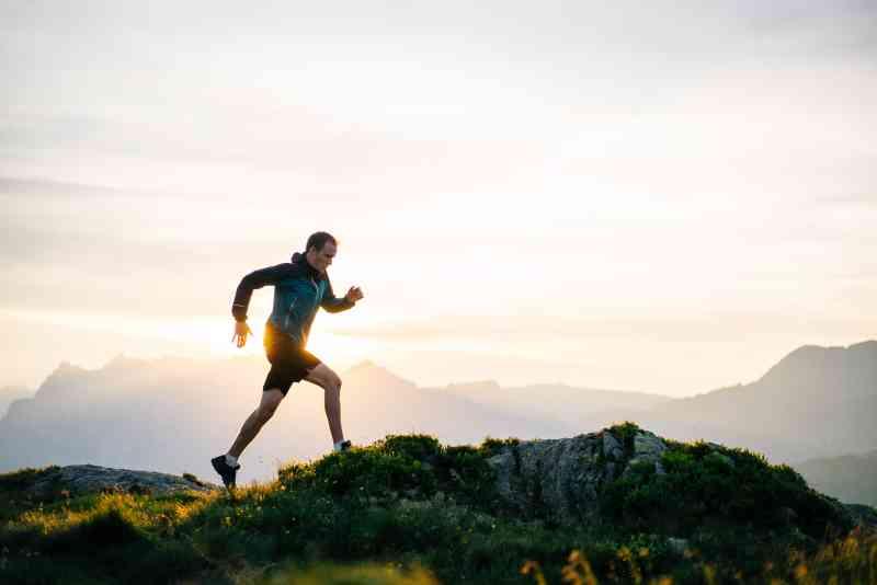 Man running on rocky hill