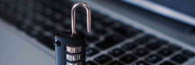 A lock in front of a laptop