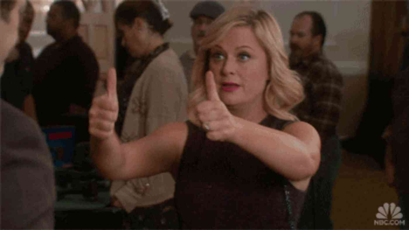 Leslie Knope from Parks and Rec giving two thumbs up