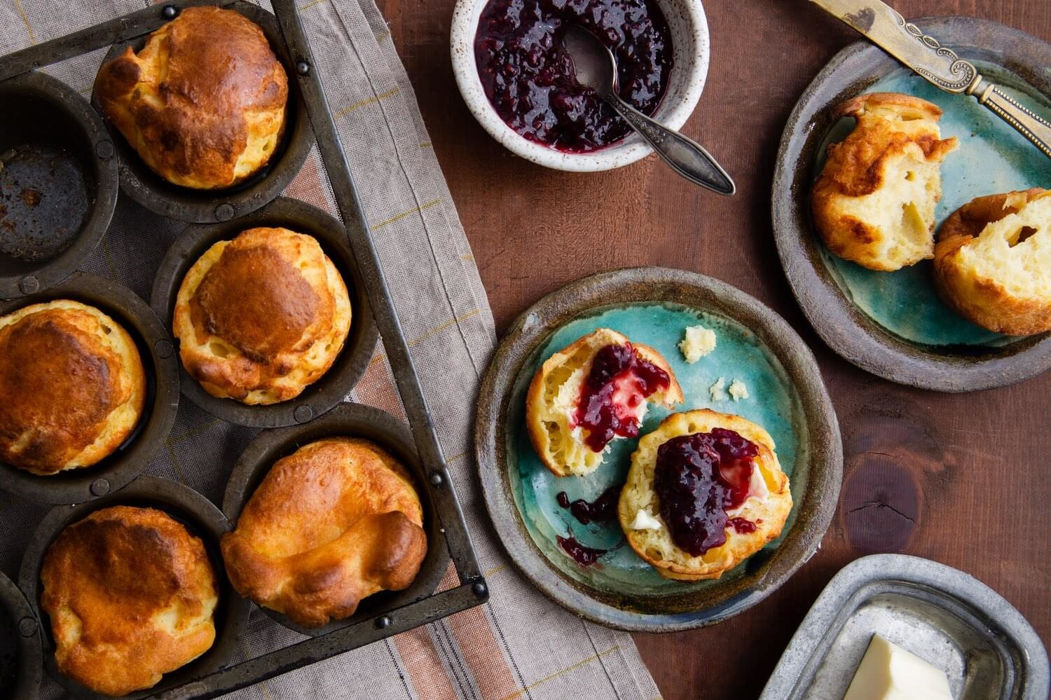 These popovers are airy on the inside and crispy on the outside. They are cooked until golden brown and topped with Nellie's Butter or preserves. | peteandgerrys.com
