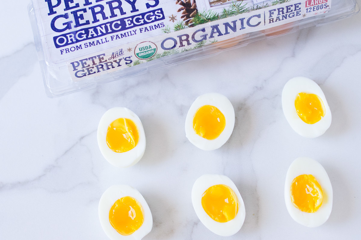 This instant pot recipe features perfect soft boiled eggs. Pictured is halved soft boiled eggs with gold luscious yolk interiors. | peteandgerrys.com