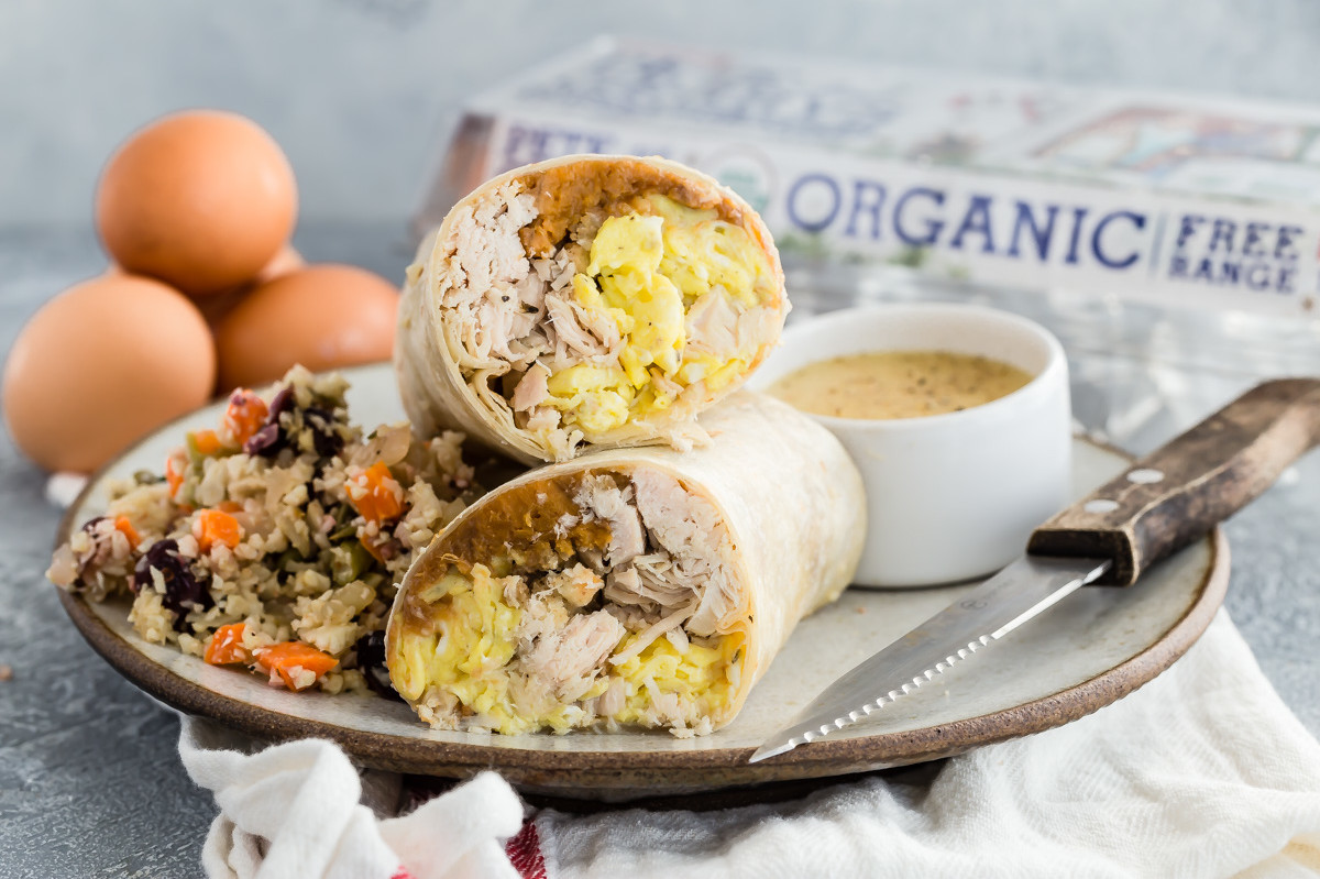 This leftovers breakfast burrito is stuffed with scrambled eggs, turkey, sweet potato mash, and gravy. | peteandgerrys.com