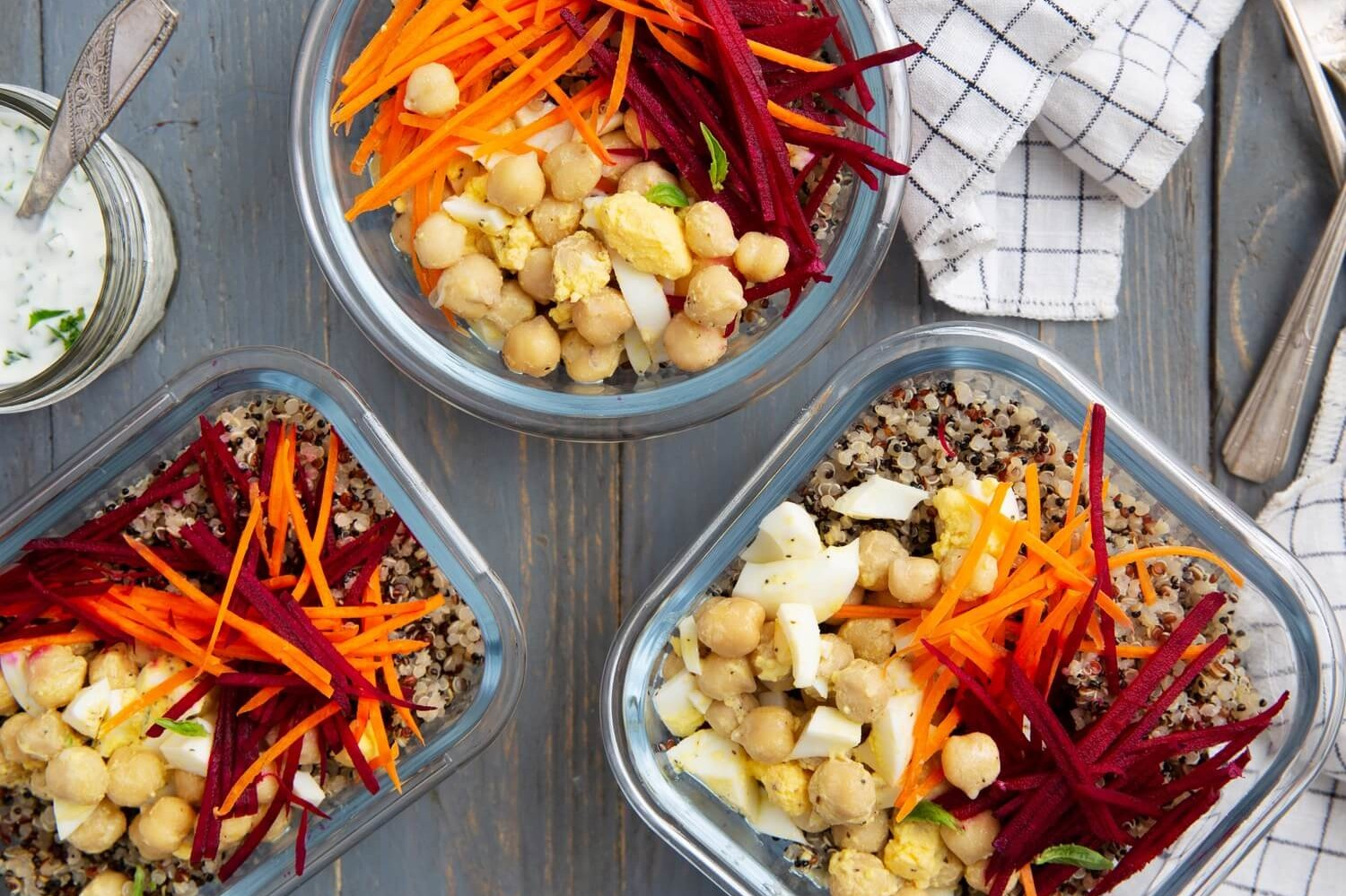 These Mediterranean bowls are the perfect make-ahead meal. They feature quinoa, hard-boiled eggs, carrots, beets, chickpeas, and a greek yogurt dressing. | peteandgerrys.com