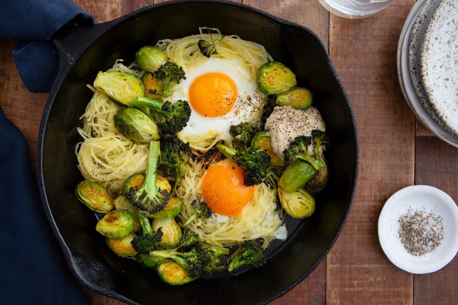 This healthy egg skillet is made with spaghetti squash, brussel sprouts, avocado oil, and organic eggs. | peteandgerrys.com