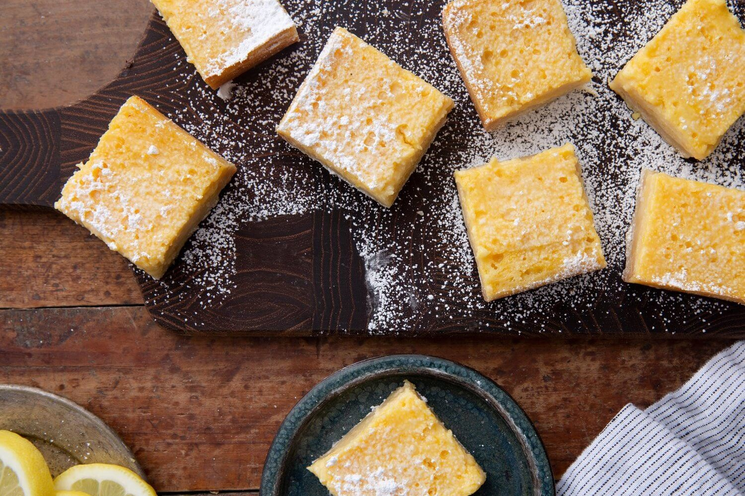 These highly acclaimed lemon ricotta bars are a summertime treat. These bars are made with fresh lemon, organic eggs, and a homemade crust. | peteandgerrys.com